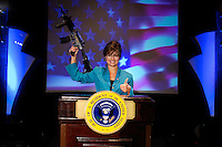 Sarah Palin impersonator gives Presidential speech while holiding machine gun