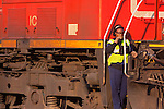 A Canadian National Brakewoman rides a set of locomotives being hostled in the yard at Homewood, IL.