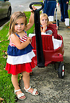 Sept. 11, 2012 - Merrick, New York, U.S. - (L-R) KATE OLLENDIKE, 2, and LYLA WILLIAMS, 3, both from Merrick, are helping to distribute 500 Luminary Bags among the 215 Wenshaw Park homes on the 11th Anniversary of 9/11, by Wenshaw Park Civic Association (WPCA), Long Island, with over $500 already raised for Twin Towers Orphan Fund.