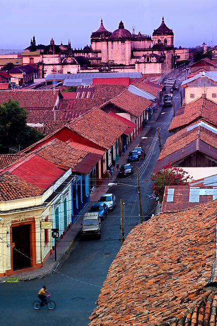 Elevated view of house rooftops and the Cathedral of Leon at dawn in Leon, Nicaragua.