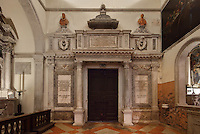 Monumental tomb of Carlo Helman, a 16th century merchant, patron and collector from Antwerp, in the Church of Santa Maria Formosa, built 1492 by Mauro Codussi, Venice, Italy. The church was built on the site of a 7th century church, 1 of 8 founded by San Magno, bishop of Oderzo. The city of Venice is an archipelago of 117 small islands separated by canals and linked by bridges, in the Venetian Lagoon. The historical centre of Venice is listed as a UNESCO World Heritage Site. Picture by Manuel Cohen