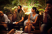 Young Indians are seen having a drink and at a roof-top lounge of a popular contemporary asian restaurant, Circa 1193 in New Delhi, India. Photograph: Sanjit Das/Panos