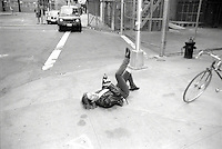 Woman on sidewalk. Lower Manhattan, NYC, USA