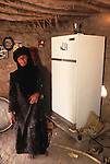 Marsh Arabs. Southern Iraq. Circa 1985. Marsh Arab woman in her adobe home with new refrigerator.
