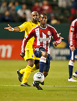 CARSON, CA – APRIL 9, 2011: Chivas USA defender Michael Lahoud (11) moves the ball up the field past Columbus Crew forward Emilio Renteria (20) during the match between Chivas USA and Columbus Crew at the Home Depot Center, April 9, 2011 in Carson, California. Final score Chivas USA 0, Columbus Crew 0.