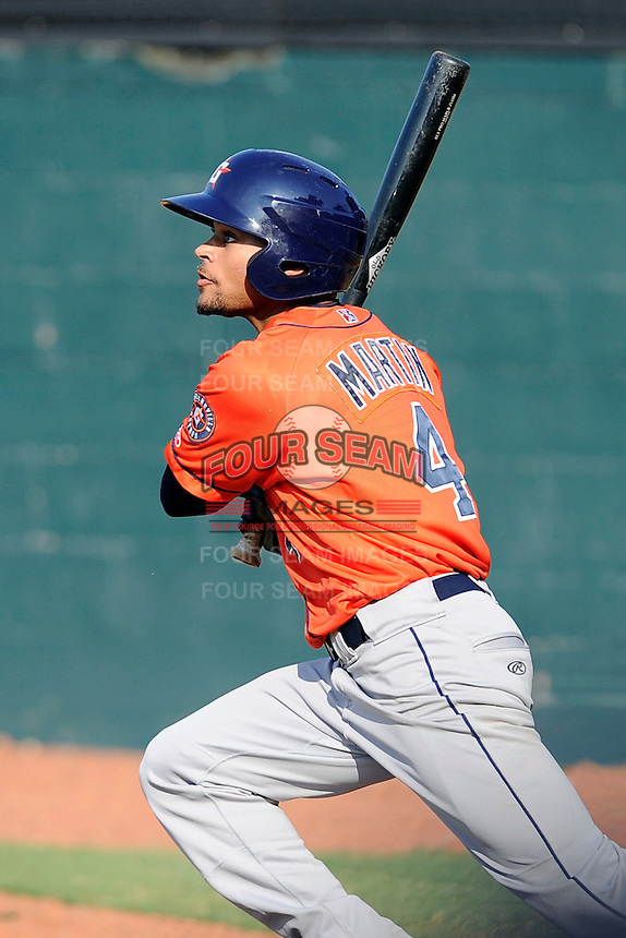 Center fielder Jason Martin (4) of the Greeneville Astros bats in a game against the Bristol Pirates on Saturday, July 26, 2014, at DeVault Memorial Stadium in Bristol, Virginia. Greeneville won, 2-1 in Game 1 of a doubleheader. (Tom Priddy/Four Seam Images)