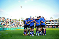 The Bath Rugby forwards huddle together during the pre-match warm-up. West Country Challenge Cup match, between Bath Rugby and Gloucester Rugby on September 26, 2015 at the Recreation Ground in Bath, England. Photo by: Patrick Khachfe / Onside Images