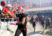 Players come out of the tunnel prior to the game. NC State defeated Central Michigan 38-24 on Saturday, October 8, 2011 at Carter-Finley Stadium in Raleigh. Photo by Al Drago.