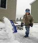 NAUGATUCK, CT. 31 DECEMBER 01_NEW_123108DA03.jpg- Ryan Dumschott, 9, of Naugatuck shovels his driveway during Wednesday winter storm.<br />  Darlene Douty