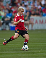 16 July 2010 Manchester United Paul Scholes No.18 in action during the warm-up in an international friendly  between Manchester United and Celtic FC at the Rogers Centre in Toronto.