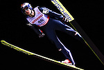 Thomas Morgenstern of Austria soars through the night skies during the FIS World Cup Ski Jumping in Sapporo, northern Japan in March, 2007.