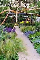 Garden sculpture artwork with gazebo, ornamental grass perennials, spiky plants, mix of textures