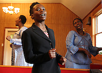 From left, congregation members Emmy Gitugu, Rebecca Maina and Beatrice Namahirwe dance in the pews during Sunday service at The Africa Lighthouse Baptist Temple near Stony Point in Albemarle County, VA. The small 10 family congregation is made up of African refugees and immigrants who's service is spoken in Swahili and translated into English. They've just signed a rent-own lease for a small church after meeting for three years at a local school. Photo/The Daily Progress/Andrew Shurtleff