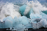 Waves crash into bergy bits, Iceland