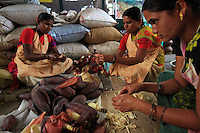 In Hasanur, women are preparing banana seeds to make chutney.