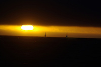 California coast sunset with sail boats seen in Monterey Bay
