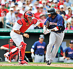 8 March 2012: Boston Red Sox outfielder Darnell McDonald is tagged out by catcher Yadier Molina during a Spring Training game against the St. Louis Cardinals at Roger Dean Stadium in Jupiter, Florida. The Cardinals defeated the Red Sox 9-3 in Grapefruit League action. Mandatory Credit: Ed Wolfstein Photo