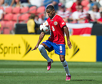 SANDY, UT - July 13, 2013: Costa Rica National Team midfielder Kenny Cunningham (8) during the Costa Rica vs Belize match at Rio Tinto Stadium in Sandy, Utah. Final score Costa Rica 1, Belize 0.