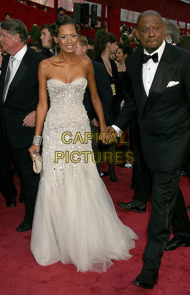KEISHA WHITAKER & FOREST WHITAKER.The 80th Annual Academy Awards Arrivals held at the Kodak Theatre, Hollywood, California, USA..February 24th, 2008.full length strapless dress white cream silver jewel encrusted black tuxedo holding hands married husband wife oscars.CAP/ADM/RE.©Russ Elliot/AdMedia/Capital Pictures.