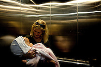 Cecilie holds Victoria in a lift at the Annapurna Neurological Institute in Kathmandu. 19 month old Victoria (formerly named Ghane) was born with hydrocephalus and was left abandoned. Cecilie Hansen was so moved by the story of Ghane she read in a Danish newspaper that she decided to fly to Kathmandu to try to assist her and show her the love of another human being; Cecilie eventually became her legal guardian. Day by day they are growing closer. 'I'm probably the closest thing to a mother she has now' says Cecilie, 'I simply couldn't bear that no one would care for her.' Victoria died on November 19 2010 from heart failure.