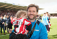 Lincoln City's assistant manager Nicky Cowley with his daughter celebrating promotion<br /> <br /> Photographer Andrew Vaughan/CameraSport<br /> <br /> Vanarama National League - Lincoln City v Macclesfield Town - Saturday 22nd April 2017 - Sincil Bank - Lincoln<br /> <br /> World Copyright &copy; 2017 CameraSport. All rights reserved. 43 Linden Ave. Countesthorpe. Leicester. England. LE8 5PG - Tel: +44 (0) 116 277 4147 - admin@camerasport.com - www.camerasport.com