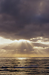 Storm clouds off the California Coast at winter time with sun breaking through clouds at sunset San Diego California USA