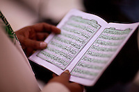 A man reads from the Koran.