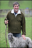 BNPS.co.uk (01202 558833)<br /> Pic: DavidFitzgerald/BNPS<br /> <br /> Kenny with his Irish wolfhound-deerhound cross Murphy.<br /> <br /> Supplying farm animals to TV and film crews, including the huge hit series Game of Thrones, has saved Kenny Gracey's bacon.<br /> <br /> The 57-year-old farmer started supplying pigs, cows, donkeys, goats and even a trained deer to Hollywood seven years ago, when the recession was hitting his business hard.<br /> <br /> Mr Gracey said the film work his animals get has helped him pay the bills and keep his business going.<br /> <br /> Forthill Farm in Tandragee, Northern Ireland, specialises in traditional breeds like Longhorn cattle and Gloucestershire old spot pigs, ideal for shows and films set in medieval times.