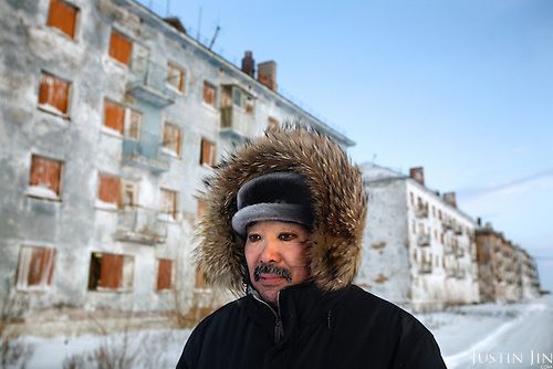 Karp Belgayev, a coal miner, walks through Yor Shor, an abandoned village near Vorkuta where he is among the last ten inhabitants. Miners say that after ten years working underground it is impossible to remove black rings from around the eyes.<br /> Vorkuta is a coal mining and former Gulag town 1,200 miles north east of Moscow, beyond the Arctic Circle, where temperatures in winter drop to -50C. <br /> Here, whole villages are being slowly deserted and reclaimed by snow.