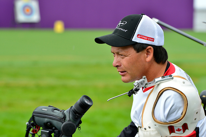 LONDON, ENGLAND 27/08/2012 - Kevin Evans of the Canadian Paralympic Archery Team goes to check his scope during a training session at the London 2012 Paralympic Games at The Royal Artillery Barracks. (Photo: Phillip MacCallum/Canadian Paralympic Committee)