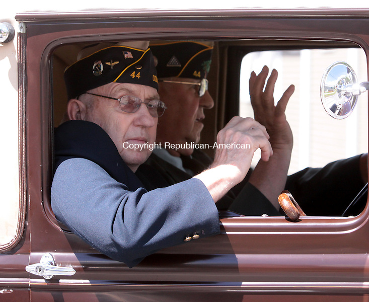 LITCHFIELD, CT - 25 May 2014 - 052514JM07 - David Weik, a member of American Legion Post 44 in Bantam, rides in a car driven by Post 44 member Owen Moore during Post 44's Memorial Day parade on Sunday. John McKenna Photo