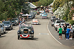 Grand marshals riding in the 1920s Ford Model A. Downtown main street during the Independence Day celebration Main Street, Mokelumne Hill, California