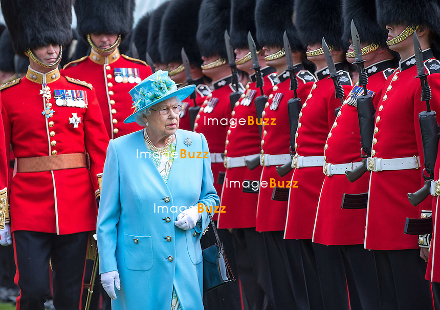 THE QUEEN ELIZABETH II<br /> Colonel-in-Chief Grenadier Guards, presented new colours to Nijmegen Company Grenadier Guards in the Gardens of Buckingham Palace. These new Colours will be ceremonially trooped  at the Queen's Birthday Parade on Horse Guards in June 2014_27/6/2013