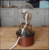 BNPS.co.uk (01202 558833)<br /> Pic: AdamBautham/BNPS<br /> <br /> ***Please use full byline***<br /> <br /> A wacky inventor who was obsessed with ticker tape machines from the 1800s has built a modern version, but instead of printing out stocks and shares - it prints out Tweets.<br /> <br /> The ticker tape was invented by Thomas Edison in 1869 and wirelessly transmitted stock information across telegraph lines.<br /> <br /> Adam Bautham, 32, was fascinated by the contraption and wanted to buy one for his own collection but found them to be incredibly expensive and hard to find.<br /> <br /> The web development manager wanted to make his own version with a modern twist, and &nbsp;built an entire machine from old clock parts that is directly linked to his Twitter feed.<br /> <br /> The 'Twittertape' has been constructed completely out of the discarded mechanisms and runs using a micro controller and a small printer.<br /> <br /> It links up to an internet network with an ethernet cable and automatically checks Adam's Twitter feed every 30 seconds, printing out new Tweets each time.<br /> <br /> The device uses paper similar to a receipt roll in a supermarket till and instead of using ink, it burns the text onto the surface.<br /> <br /> Adam spent three months building the Twittertape at home on his kitchen table and is hoping to have them commercial produced after receiving many enquiries.<br /> <br /> The device could link up to any Twitter feed, including those owned by celebrities and companies.