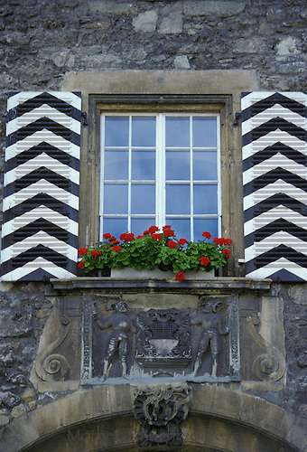 Window in german stone house with chevron shutters for Window in german