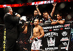 August 8, 2009; Philadelphia, PA; USA; BJ Penn (white trunks) and Kenny Florian (black trunks) fight for Penn's UFC Lightweight Championship title at the Wachovia Center in Philadelphia, PA.  Penn won via rear naked choke.