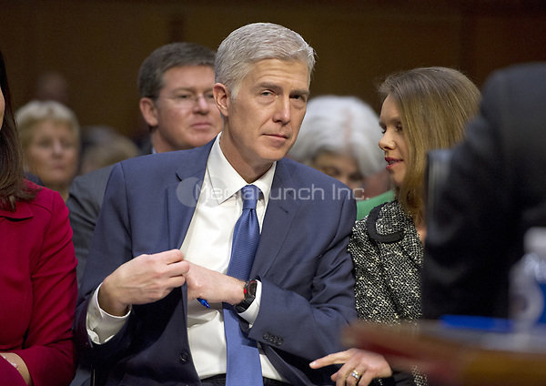 Judge Neil Gorsuch and his wife, Marie Louise, as he prepares to testify before the United States Senate Judiciary Committee on his nomination as Associate Justice of the US Supreme Court to replace the late Justice Antonin Scalia on Capitol Hill in Washington, DC on Monday, March 20, 2017.<br />Credit: Ron Sachs / CNP / MediaPunch<br />(RESTRICTION: NO New York or New Jersey Newspapers or newspapers within a 75 mile radius of New York City)