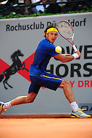 Juan Monaco ready to backhand during the semifinal at the Power Horse Cup 2013 at Rochusclub in Duesseldorf, Germany on May 24, 2013. Photo: Miroslav Dakov