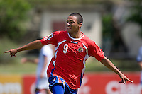 John Ruiz (9) of Costa Rica celebrates his goal during the group stage of the CONCACAF Men's Under 17 Championship at Jarrett Park in Montego Bay, Jamaica. Costa Rica defeated El Salvador, 3-2.
