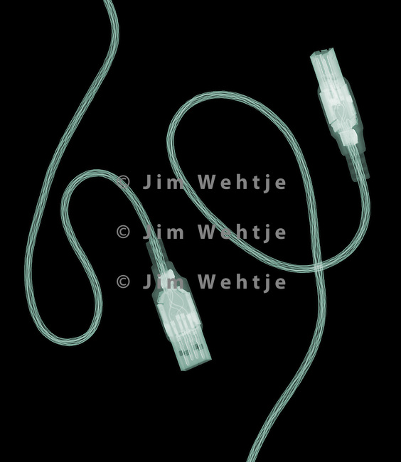 X-ray image of a USB cable (green on black) by Jim Wehtje, specialist in x-ray art and design images.