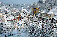 Bosnia and Herzegowina. Republika Serpska. Srebrenica. View on the town during the winter season.The muslim mosque and the orthodox church. © 2005 Didier Ruef