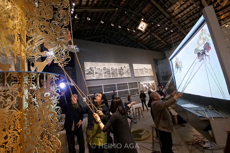 57th Art Biennale in Venice - Viva Arte Viva.<br /> Arsenale. China.<br /> Continuum-Generation by Generation.<br /> Shadow play performance.