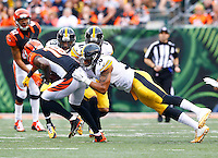Ryan Shazier #50 of the Pittsburgh Steelers attempts to tackle A.J. Green #18 of the Cincinnati Bengals following a catch during the game at Paul Brown Stadium on December 12, 2015 in Cincinnati, Ohio. (Photo by Jared Wickerham/DKPittsburghSports)