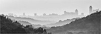 There is a scenic viewpoint along 360 west of Austin. On this morning, I was returning from shooting at Pennybacker Bridge when I noticed the fog and outline of the Austin skyline I turned around and captured a few images of the layered hills and downtown Austin. This is the black and white version of the foggy morning.