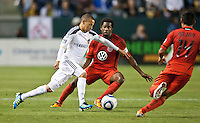 CARSON, CA – June 3, 2011: LA Galaxy midfielder Paolo Cardozo (30) moves the ball past DC United midfielder Clyde Simms (19) during the match between LA Galaxy and DC United at the Home Depot Center in Carson, California. Final score LA Galaxy 0, DC United 0.