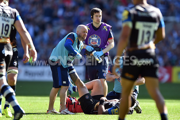 Bath Rugby physiotherapist Cerian Parham treats a player for cramp. The Clash, Aviva Premiership match, between Bath Rugby and Leicester Tigers on April 8, 2017 at Twickenham Stadium in London, England. Photo by: Patrick Khachfe / Onside Images