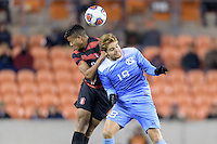 Houston, TX - Friday December 9, 2016: Brian Nana-Sinkam (8) of the Stanford Cardinal heads the ball over Alan Winn (18) of the North Carolina Tar Heels at the NCAA Men's Soccer Semifinals at BBVA Compass Stadium in Houston Texas.
