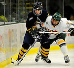 30 December 2007: University of Vermont Catamounts' defenceman Slavomir Tomko, a Senior from Zvolen, Slovakia, checks Quinnipiac University Bobcats' Dan Travis during a game against the Quinnipiac University Bobcats at Gutterson Fieldhouse in Burlington, Vermont. The Bobcats defeated the Catamounts 4-1 to win the Sheraton/TD Banknorth Catamount Cup Tournament...Mandatory Photo Credit: Ed Wolfstein Photo