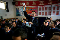 Taxi driver Liu Shao Shan teaches English to fellow cabbies at their office headquarters in Beijing, which is getting ready to host the 2008 Olympic Games..