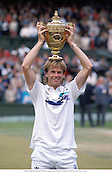 STEFAN EDBERG (SWE) with the Men's Singles trophy, Wimbledon 8807 Photo:Richard Francis/Action Plus...Tennis.1988.Winners.trophies.cup cups.man